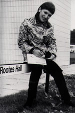 A student sitting on a Rootes sign in the late 1960s